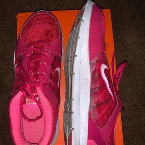 Women's size 12 pink tone Nike running shoes